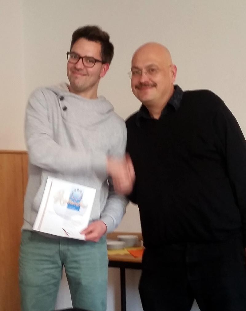 Bastian Pelz erhält die Goldene Ehrennadel des DPV für seine langjährige Tätigkeit im Präsidium des PV Ost